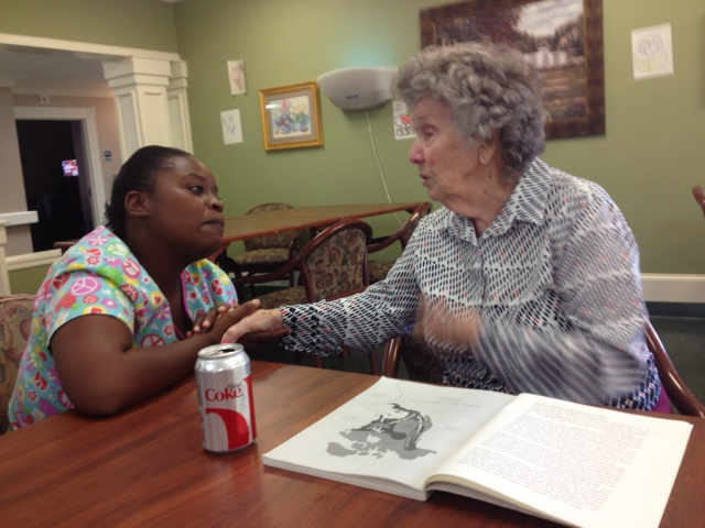 Betty asking her CNA, Crystal, if she is feeling okay.
